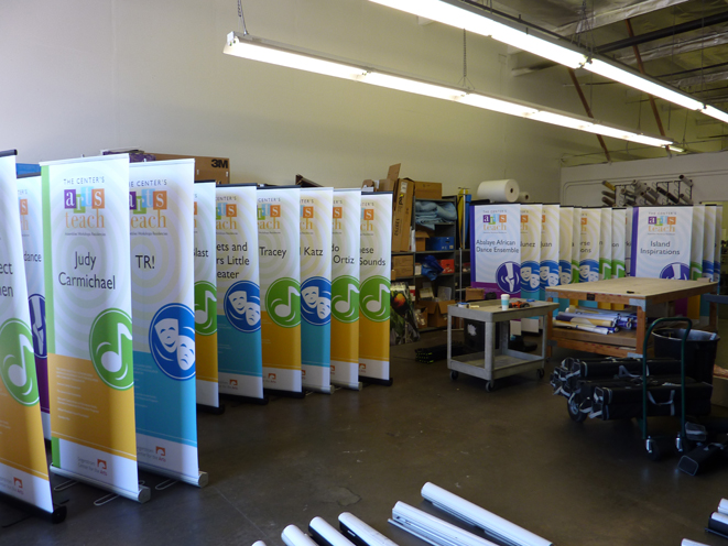 large quantity production of banners and stands with attention to detail